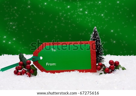 A thank you card sitting on snow with a green background, Christmas Gift Tag - stock photo