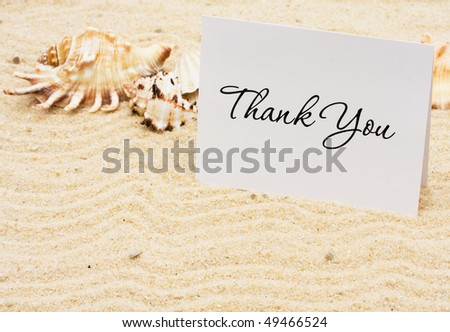 A thank you card with sea shells on a sand background, Thankful for Vacation Time - stock photo