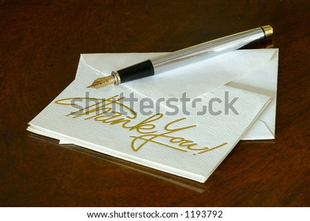 A thank you note with a fountain pen on the image - stock photo