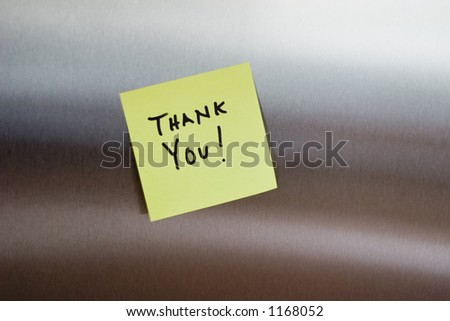 A thank you post it note on a stainless fridge - stock photo