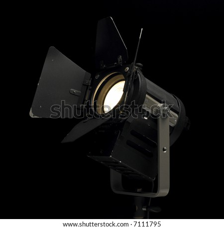 A theater/photo/movie lamp heading upwards. - stock photo