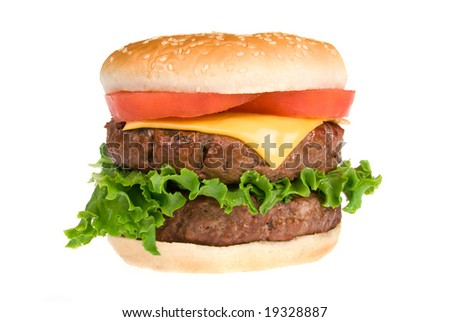 A thick, fresh and juicy hamburger with all the trimmings isolated on white. - stock photo