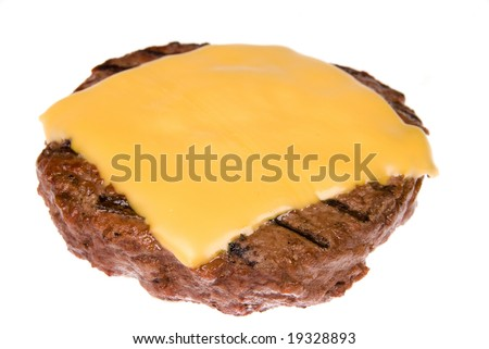A thick, juicy hamburger patty with a melted slice of cheese freshly cooked on a barbecue and isolated on white. - stock photo