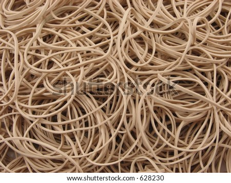 A thick pile of rubber bands close-up and well-lit - stock photo