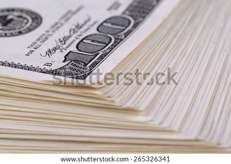 A thick wad of hundred-dollar bills USA - stock photo