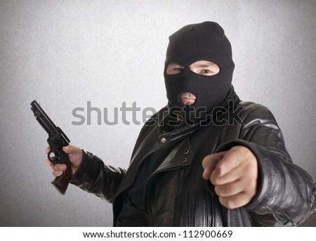 a thief, after docking at gunpoint - stock photo