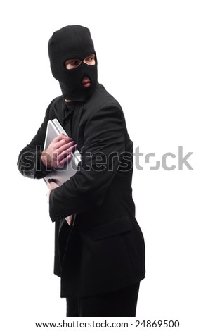 A thief holding a laptop is getting paranoid and looking over his shoulder, isolated against a white background