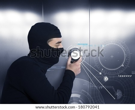 A thief tries to open a safe in a bank - stock photo