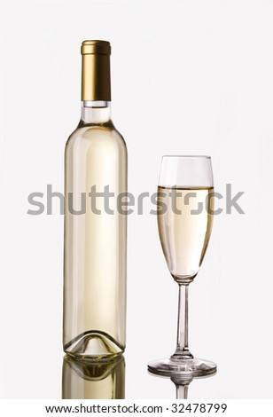 A thin bottle of white wine and a glass full of it isolated on white. It has a clipping path. - stock photo