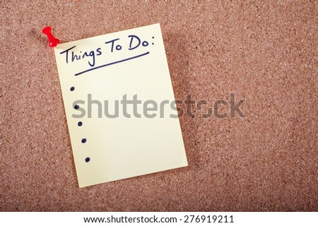 A Things To Do List pinned to a noticeboard. - stock photo