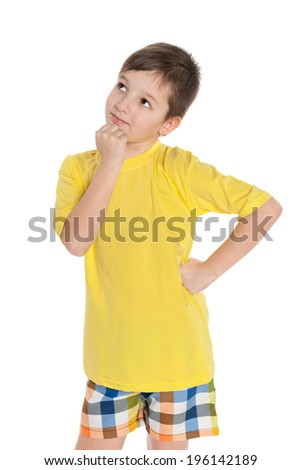 A thinking young boy in the yellow shirt on the white background