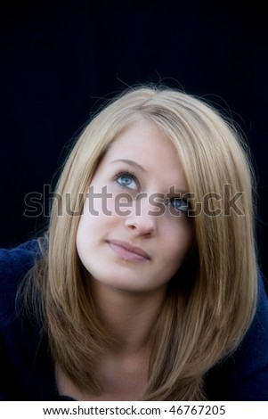 a thinking young lady - stock photo