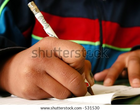 A third-world country student writing homework - stock photo