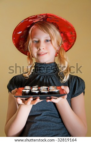a thirteen years old girl with sushi-platter - stock photo