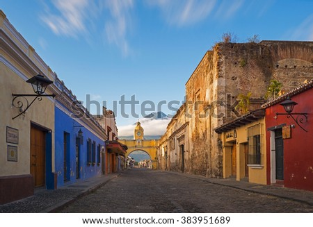"""A thirty seconds exposure of the historic center of Antigua at sunrise, Guatemala. Translation text left: """"textura"""" = texture; """"cuida tu planeta"""" = Take care of your planet. - stock photo"""