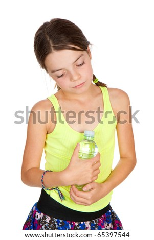 A thoughful looking primary aged girl holding a full bottle of mineral water.