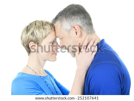 A Thoughtful couple hugging - isolated over white