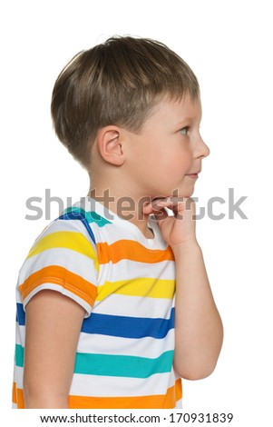 A thoughtful little boy looks aside on the white background - stock photo