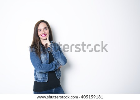 A Thoughtful woman, isolated over a gray background - stock photo