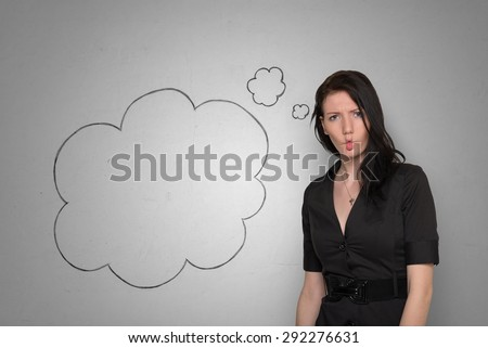 A thoughtful young woman in black dress on a white background