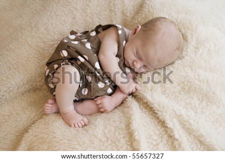 A three week old baby girl sleeping, soft focus - stock photo