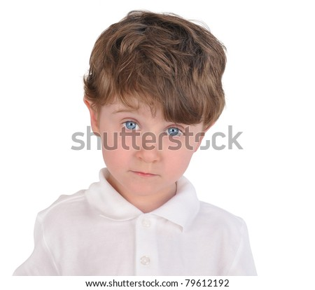 A three year old boy is isolated on a white background and looks sad and curious. He has a white shirt on. - stock photo