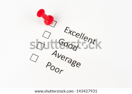A thumbtack pinned on excellent, other options include good, average and  poor - stock photo