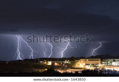 A thunderstorm advances on a small college campus