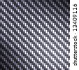 A tightly woven carbon fiber background texture - a great art element for that high-tech look you are going for.  This one has bright highlights to portray the reflectivity in real carbon fiber. - stock photo