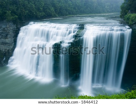 A time exposure of the middle falls in Letchworth State Park on the Genesee River. - stock photo
