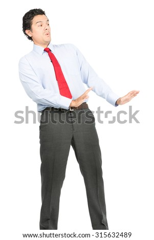 A timid, intimidated hispanic man in business clothes, dress shirt, tie in a defensive posture, appeasing, leaning back, holding hands out to calm imaginary aggressive opponent down. Vertical - stock photo