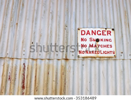 A tin Danger, No Smoking sign