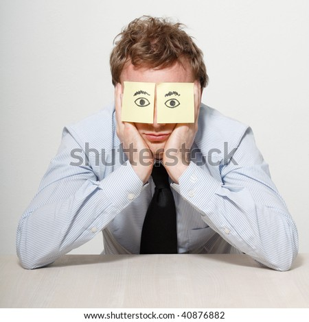 A tired business man sleeping - stock photo