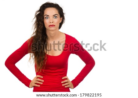 A tired, frustrated and fed up woman looking at camera. Isolated on white. - stock photo