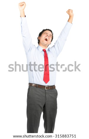 A tired hispanic male office worker in business clothes raising arms up high stretching, tilting head back yawning showing weary attitude to hard day's work - stock photo