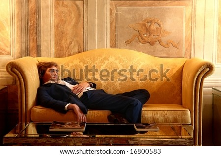 a tired man on a sofa - stock photo