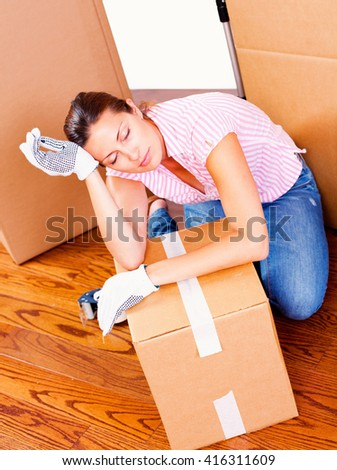 A tired woman during move.