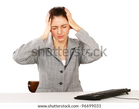 A tired woman sitting on the desk, isolated on white background - stock photo