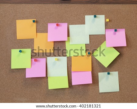 A To Do List with colorful post it papers on cork notice board