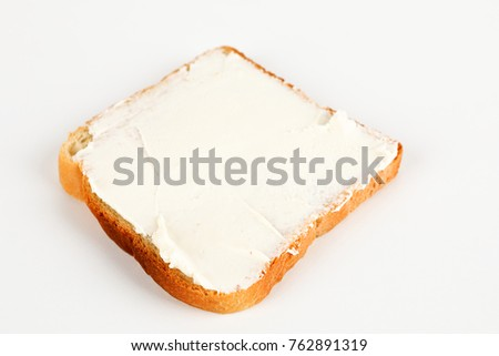a toast with cream cheese and white background