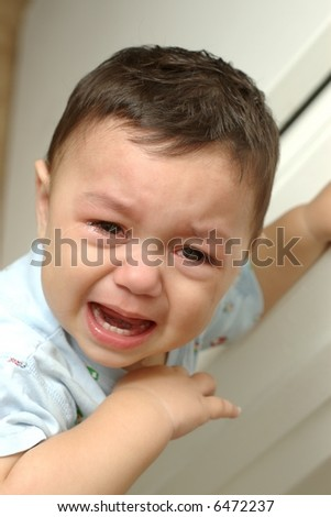 A toddler boy's tearful face