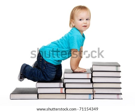 A toddler crawl for education represented by a conception steps made of books - stock photo