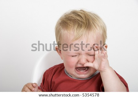 A toddler having a tantrum - stock photo
