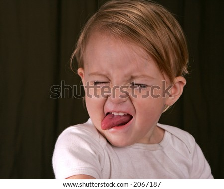 A toddler making a face - stock photo