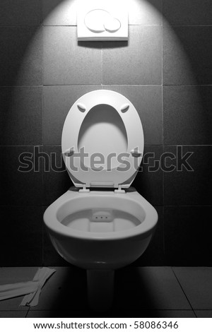 A TOILET IS A SANITATION FIXTURE USED PRIMARILY FOR THE DISPOSAL OF HUMAN URINE AND FECES. THEY ARE OFTEN FOUND IN A SMALL ROOM REFERRED TO AS A TOILET, BATHROOM OR LAVATORY.  - stock photo