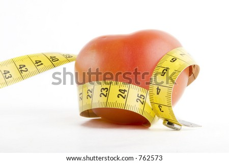 A tomato wrapped in a tape measure