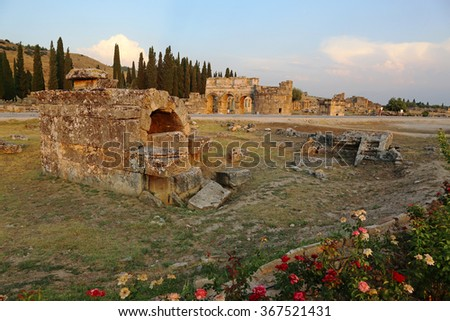 A tomb at the Hierapolis site shot at dusk. It was an ancient Greek city located on the hot springs in modern day Pamukkale, Turkey.  - stock photo