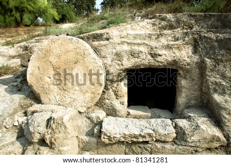 A tomb near nazareth, Israel dates to the first century. Similar to Christ's tomb with the stone rolled over the entry. - stock photo