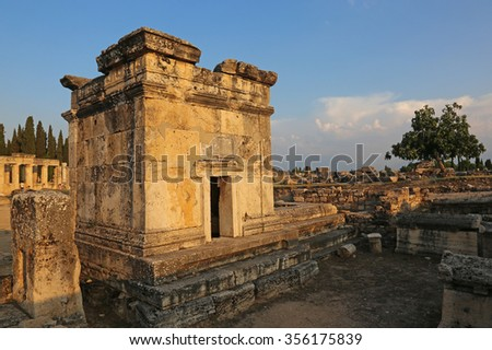 A tombo at the Hierapolis site shot at dusk. It was an ancient Greek city located on the hot springs in modern day Pamukkale, Turkey.  - stock photo