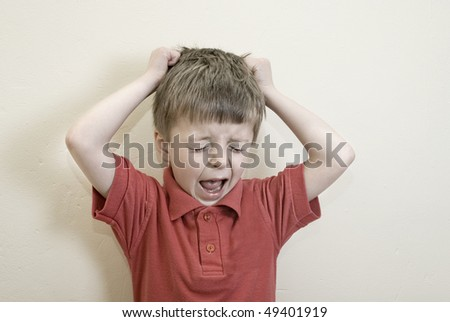A toned image of a child displaying challenging behaviour. - stock photo